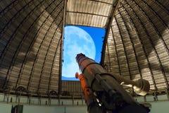 Athens, Greece 5 November 2016. Huge telescope against the full moon at Penteli observatory Royalty Free Stock Image