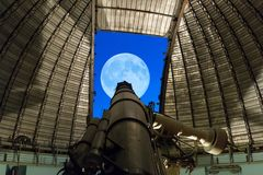 Athens, Greece 5 November 2016. Observing the night sky with full moon with a big telescope at Penteli observatory Stock Images