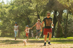 Athens, Greece 4 October 2015. Family running at the park in family competition run with your dog in Greece. Royalty Free Stock Photos
