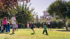 Athens, Greece 4 October 2015. Kids playing in a park old traditional games. stock image