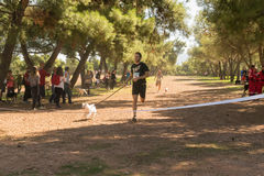 Athens, Greece 4 October 2015. Man ready to cross the finishing line at competition run with your dog in Greece. Royalty Free Stock Photo