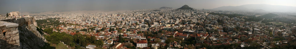 Athens, Greece. ATHENS, GREECE - OCTOBER 20, 2008: Mount Lycabettus rising over the historical centre in Athens, Greece. Panorama from the Acropolis of Athens Stock Photo