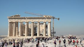 Tourists near ruins of Parthenon temple in Acropolis stock video footage