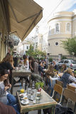 Athens. GREECE - OCTOBER 26, 2015: Young people throng the terraces of bars and restaurants Royalty Free Stock Photo