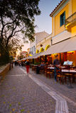 Athens, Greece. People in a street near ancient Agora with many restaurants and coffee shops, Athens Stock Image