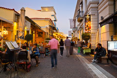 Athens, Greece. People in a street near ancient Agora with many restaurants and coffee shops, Athens Stock Photo