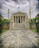 Athens Greece, Plato and Socrates statues in front of the national academy neoclassical building. Central perspective and slight vignetting stock images