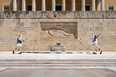 Athens, Greece - 27.04.2019: Presidential guards perform a ceremonial change of guard in front of the Tomb of the Unknown soldier stock photos