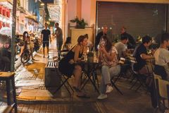 ATHENS, GREECE - SEPTEMBER 16, 2018: Athens nightlife. Chilling out at the bars stock photography