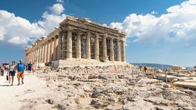 ATHENS, GREECE - SEPTEMBER 16, 2018: Large group of tourists visiting ancient temple Parthenon on Acropolis royalty free stock images