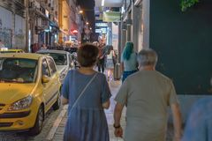 ATHENS, GREECE - SEPTEMBER 16, 2018: Night views of Athens city. People relaxing after work. Night in Athen, Greece stock photo