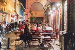 ATHENS, GREECE - SEPTEMBER 16, 2018: Night views of Athens city. People relaxing after work. Outdoor restaurant at Plaka. By night in Athen, Greece royalty free stock photo