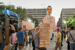 Athens, Greece 18 September 2015. Protestant with a caricature of Alexis Tsipras giving an interview to a local channel. Stock Image