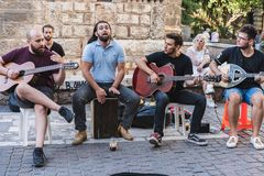 ATHENS, GREECE - SEPTEMBER 17, 2018: Street musicians in Plaka, Athens. ATHENS, GREECE - SEPTEMBER 17, 2018 Street musicians Plaka Athens Greece stock photo