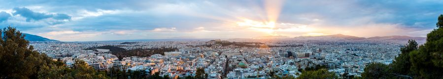 Athens, Greece at Sunset. Athens/Greece - February 16, 2015: A hilltop view of Athens, Greece at Sunset royalty free stock photo