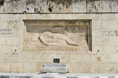 Athens, Greece. Tomb of The Unknown Soldier outside Greek Parliament. It depicts a dead soldier lying, with his shield on his left hand royalty free stock image