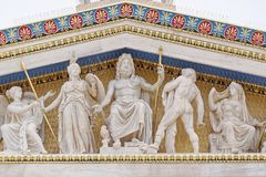 Athens Greece, Zeus, Athena and other ancient greek gods and deities. Colorful sculptures on national academy pediment royalty free stock photo