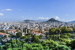Athens and lycabettus. Panoramic view of the city of Athens from the hill of Philopappos in which Mount Lycabettus stands the tallest of Athens Royalty Free Stock Image