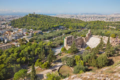 Athens - The Odeon of Herodes Atticus or Herodeon under The Acropolis in morning light and the town. Panorama Stock Image