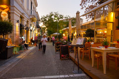 Athens. People in a street near ancient Agora with many restaurants and coffee shops, Athens Royalty Free Stock Photos