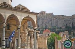 Athens Plaka. Central Athens, Greece. Photo shows the Plaka shopping area with the Parthenon and Acropolis in the background. The sign designates the Monastriki stock photos