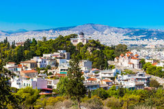 Athens skyline with Hill of the Nymphs, and church Agia Marina Royalty Free Stock Photo
