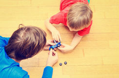 Ather teaching son how to repair toy car Stock Images