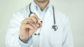Atherosclerosis, Doctor Writing on Transparent Screen. Man writing stock video
