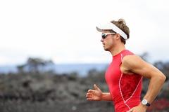 Athlète courant de triathlon Photographie stock libre de droits