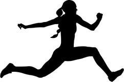 Athlète de femme sautant le saut triple Photo libre de droits