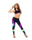 Athlète féminin assez bouclé posant à l'appareil-photo Photos libres de droits