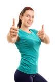 Athlète féminin composant des pouces Images stock