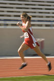 Athlète féminin Running With Baton photos stock