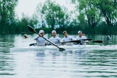 Athlète quatre dans un kayak Photos libres de droits
