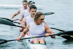 Athlète quatre dans un kayak Photo libre de droits