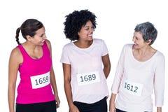 Athlètes féminins de sourire Images stock
