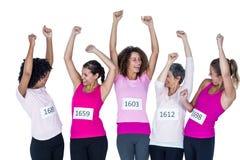 Athlètes heureux avec des bras augmentés Photos libres de droits