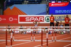 Athlétisme - obstacles des femmes 60m - Milica Emini Photographie stock libre de droits