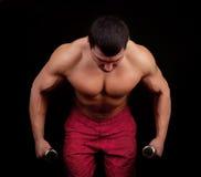 Athlet, der Übung tut Stockfoto
