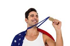 Athlet, der Goldmedaille nach Sieg hält Lizenzfreies Stockbild