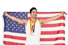 Athlet, der mit Goldmedaillen nach Sieg aufwirft Stockbilder