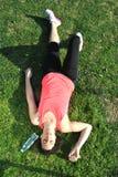 Athlet ermüdet und Lügen Stockbild