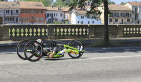 Athlet of hand-bike. Giro d'Italia (Tour of Italy) HandBike 2015 and Paracycling Italian Tour. Handcycling classifications were included at the stock photo