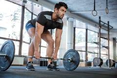 Athlet lifting barbell royalty free stock photo