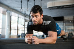 Athlet making static exercise Royalty Free Stock Image