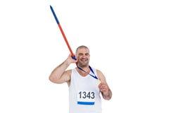 Athlet mit der olympisches Goldmedaille, die Speer hält Lizenzfreie Stockfotografie