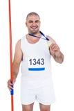 Athlet mit der olympisches Goldmedaille, die Speer hält Stockfotos
