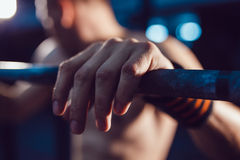 Athlet preparing for barbell exercises Stock Image
