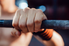 Athlet preparing for barbell exercises stock photography