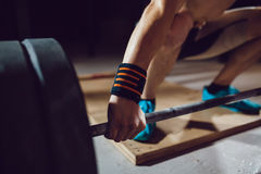 Athlet preparing for barbell exercises Stock Images